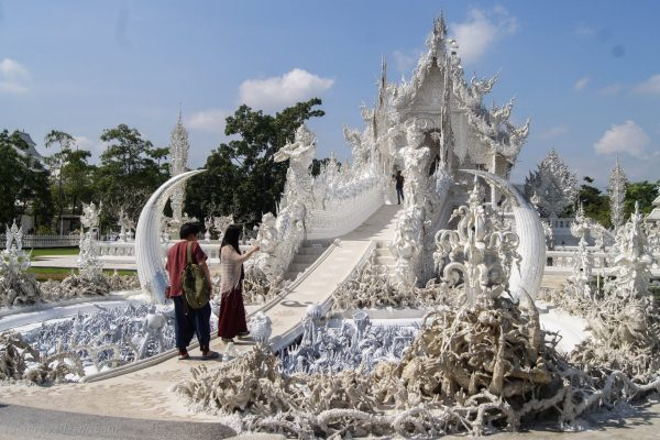 The front of Wat Rong Khun with the skulls, hands and demons