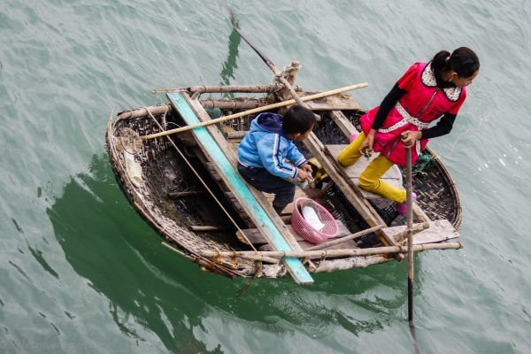 Kids trying to sell items from their boat
