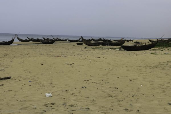 A remote beach used as boat storage