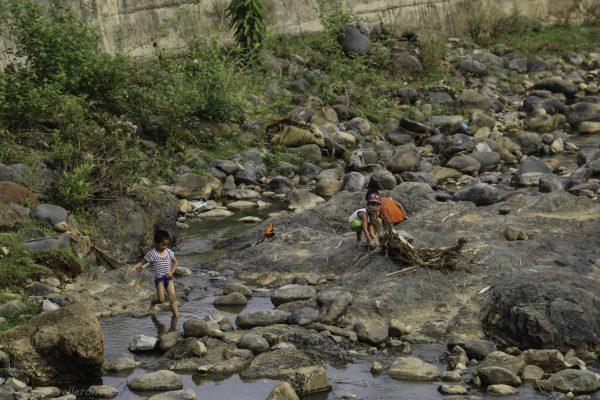 Kids enjoying the dry river bed