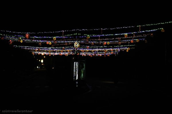 The street lid up with fairy lights