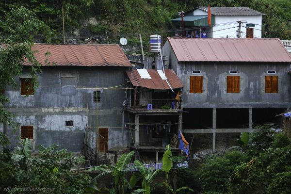 Houses hanging over the slope