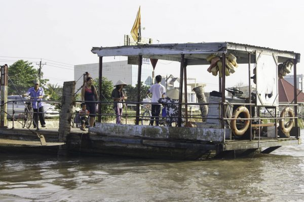 Little boat to cross pne of the arms of the Mekong