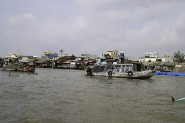 Boats and houses we passed on the Mekong