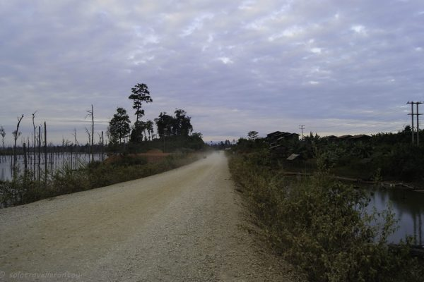 The dirt road towards Thalang