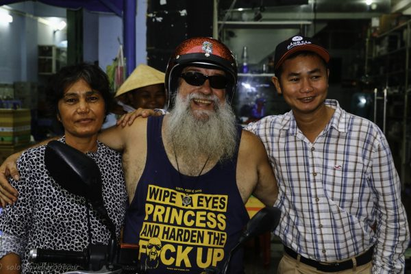Pierre showing off his beard, and the female owner of the Flan stall
