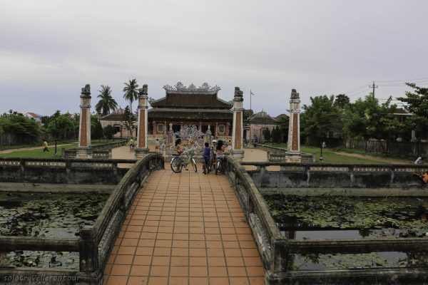 Temple outside the Ancient town where local kids enjoy a game of football