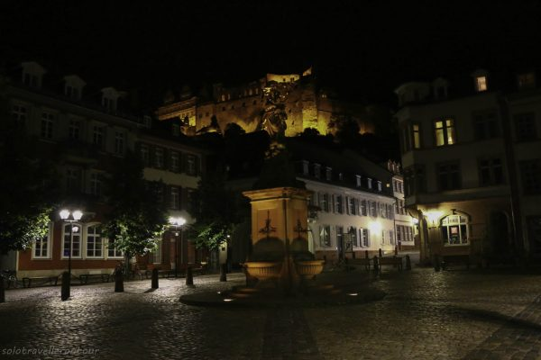 Kornmarket with the castle in the background by night