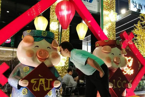 Kissing the pig for good luck in the Year of Pig