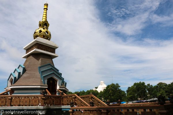"""Part of the temple and a """"small"""" Buddha statue"""