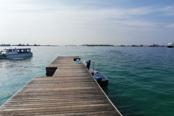 The wooden pier for private transfer at Humhumale terminal